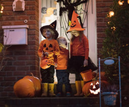 kids preparing to go trick or treating on Halloween