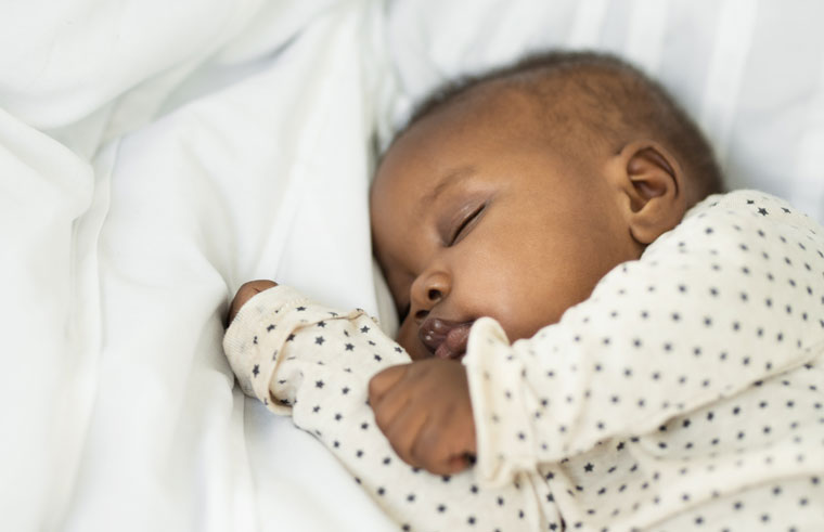 African-American sleeping baby with fuzzy hair