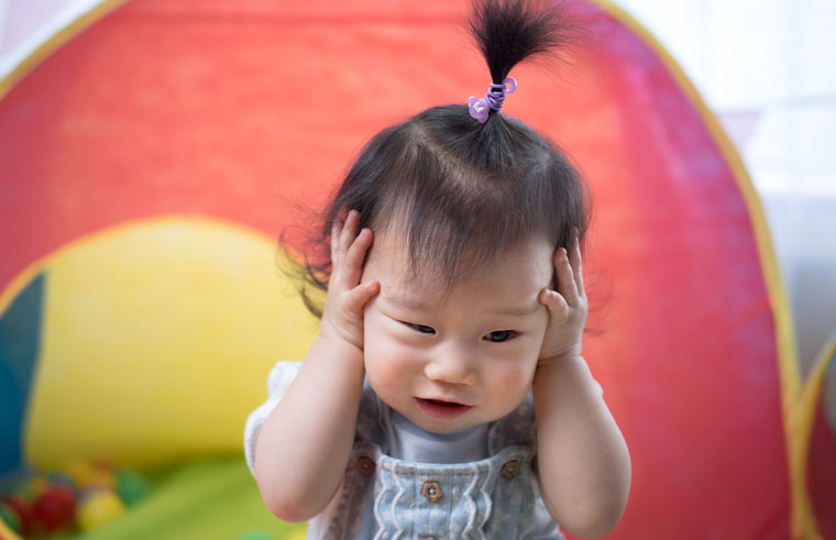 Asian baby with fountain style pony tail