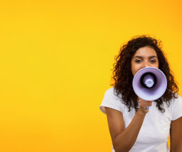 Woman with megaphone - feature