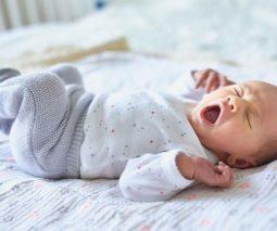 Baby yawning on back