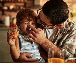 Toddler and dad eating