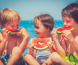 Kids eating watermelon thumb