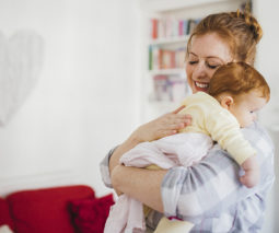 Mother holding readhead baby feature