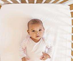 Baby lying awake in cot thumbnail