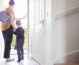 Mother and school boy at front door - feature