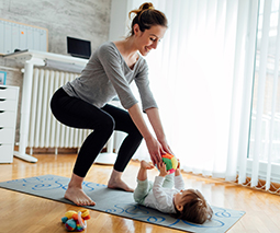 Mother exercising with baby in nursery thumbnail