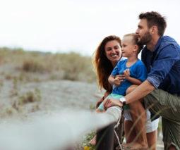 Family of three at beach