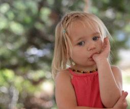 Little girl sucking her thumb
