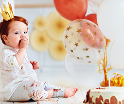 Birthday baby sitting on floor eating birthday cake thumbnail