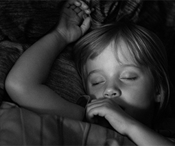 Child asleep sucking thumb