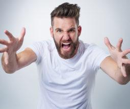Angry man yelling at camera