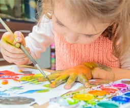 Toddler painting at home