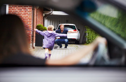 Kid running to dad from car