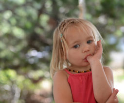 Young girl sucking her thumb - feature