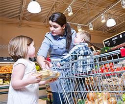 Mum with kids in supermarket
