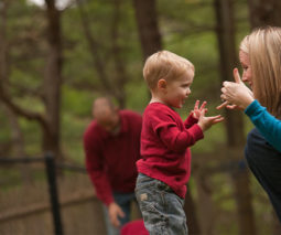 Toddler and mum signing to each other in the park