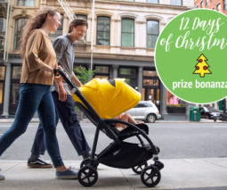 Couple walking baby in Bugaboo Bee 6 pram - 12 Days of Christmas giveaway