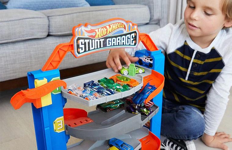 Boy playing with Hot Wheels Stunt Garage toy