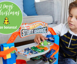 Boy playing with Hot Wheels Stunt Garage - 12 Days of Christmas giveaway