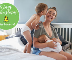 Mother holding baby toddler kissing - feature