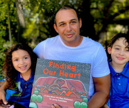 Author Thomas Mayor with his picture book Finding Our Heart