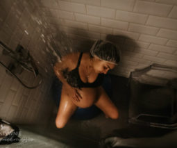 Woman in labour in shower - feature