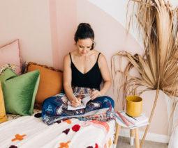 Life coach Adele Maree sitting on bed
