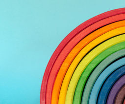 Rainbow blocks on a light blue background