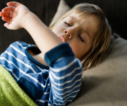 Child coughing in bed