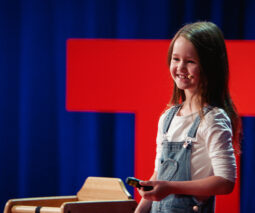 Molly Wright on stage during her Ted talk