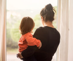 Mum and child looking out window