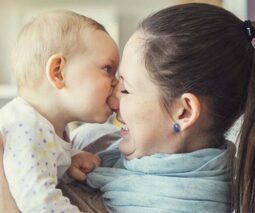 Baby biting mum on the nose